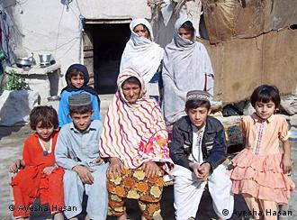 Jannat Bibi poses for a picture with seven of her children