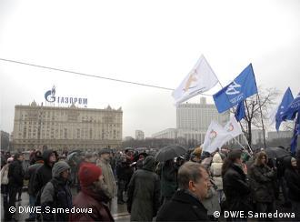 Demonstrators march in front of the Gazprom building in Moscow