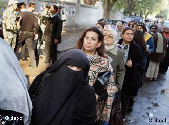 Egyptian women line up out side a polling center in Cairo