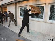 Iranian protesters smashing windows of the British embassy in Tehran