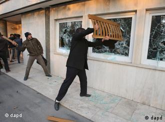 Iranian protesters smashing windows of the British embassy in Tehran