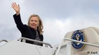 Hillary Clinton waves prior to boarding her airplane