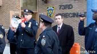 Police captain Robert Gardner with a megaphone