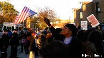 A protester waves an American flag