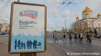 A State Duma pre-election campaign agitation poster in Moscow.
