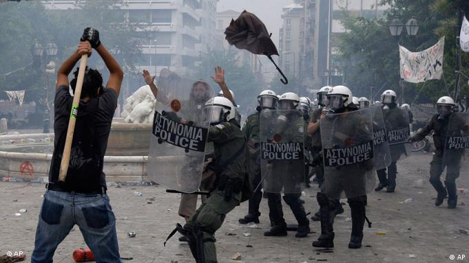 A protester prepares to hit riot police with a stick during clashes on June 29, 2011. Photo: AP Photo/Petros Giannakouris