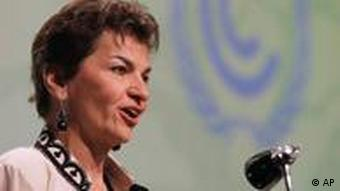 U.N. climate official Christiana Figueres speak during the opening ceremony of the climate conference in the city of Durban, South Africa, Monday, Nov 28, 2011. International negotiations have opened under the U.N. climate treaty to seek ways to curb ever-rising emissions of climate-changing pollution. South African President Jacob Zuma is to address delegates from more than 190 countries who will try to resolve differences between rich and poor countries on responsibilities for emissions cuts.(AP Photo/Schalk van Zuydam)