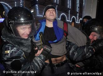 Russian demonstrators and police confronting each other