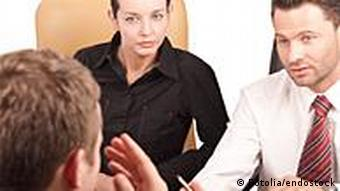 Three people in a meeting
