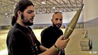 Men inspecting weapons