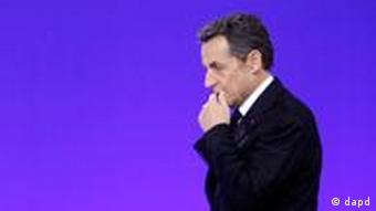 French President Nicolas Sarkozy pauses before answering questions during a media conference at an EU summit in Brussels on Friday, Dec. 9, 2011. European leaders are wrestling over how much of their sovereignty they are willing to give up in a desperate attempt to save the ambitious project of continental unity that grew from the ashes of World War II. At stake at the summit in Brussels, which began Thursday evening, is not only the future of the euro, but also the stability of the global financial system and the balance of power in Europe. (AP Photo/Michel Euler)