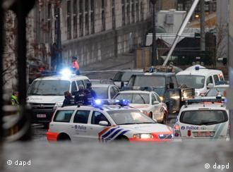 Ambulances are seen at the scene of incident in Liege, Belgium, on Tuesday, Dec. 13, 2011. Belgian news organizations are reporting that two people have been killed and at least 10 wounded Tuesday when three men attacked a crowd in the eastern Belgian city with hand grenades and gunfire. (Foto: Virginia Mayo/AP/dapd)