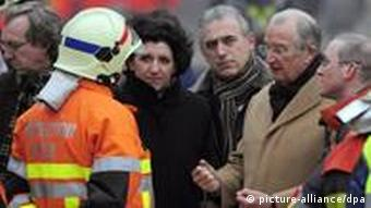 Interior Minister Annemie Turtelboom (Open Vld Flemish liberals) and King Albert II pictured as they visit the site of a gas explosion that occured at 1h45 in the night, in a building of five floors, at number 18 of the Leopold street, in Liege city center, Wednesday 27 January 2010. The rest of the building collapsed at seven o'clock and that made lots of damages, at least fifty persons were taken to a crisis center, twenty persons were brought to hospital (two severely injured) and five persons could be under the debris. The explosion was very heavy, windows from cars and other buildings in the neighbourhood were broken. BELGA PHOTO ERIC LALMAND