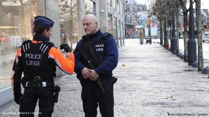 LIEGE, Dec. 13, 2011 (Xinhua) -- Policemen blockade the attack scene in the eastern Belgian town of Liege, Dec. 13, 2011. Four people were killed and 75 others wounded as a man armed with grenades, a rifle and a pistol started a killing spree here on Tuesday. (Xinhua/Wang Xiaojun) XINHUA /LANDOV