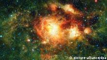 NASA handout photograph made available 17 August 2010 showing an infrared image taken by NASA's Wide-field Infrared Survey Explorer (WISE), showing a star-forming cloud teeming with gas, dust and massive newborn stars. WISE, which is surveying the whole sky in infrared light, is particularly sensitive to the warm dust that permeates star-forming clouds like this one. In this way, WISE complements visible-light observations. The mission complements Hubble and other telescopes by showing the 'big picture,' providing context for more detailed observations. The cluster contains some of the most massive stars known. Winds and radiation from the stars are evaporating and dispersing the cloud material from which they formed, warming the cold dust and gas surrounding the central nebula. The greenish 'halo' of warm cloud material is seen best by WISE due to its large field of view and improved sensitivity over past all-sky infrared surveys. EPA/NASA/HANDOUT EDITORIAL USE ONLY/NO SALES +++(c) dpa - Bildfunk+++
