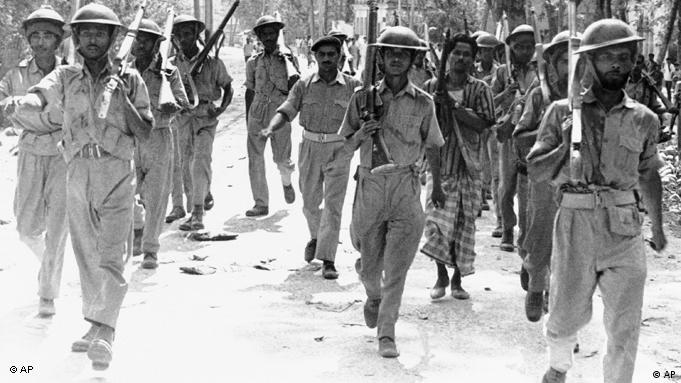 "Troops of the Bangla Desh ""Freedom Army"" march through the city of Jessore, April 2, 1971, where secessionist forces maintained a tenous control on Friday. The freedom army is composed of the East Pakistani rifles, a former regular Pakistani army unit which to a man joined in the rebellion, and East Pakistani police, as well as Bengali volunteers. Strong west Pakistani forces have dug in outside Jessore. (AP Photo)"