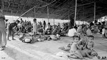 Refugee camp in Benapol, near the East Pakistan border, on April 14, 1971, with more than 5,000 refugees from the Jessore area. The refugees arrive at the rate of about 500 daily receiving food from India. (AP Photo/Michel Laurent)