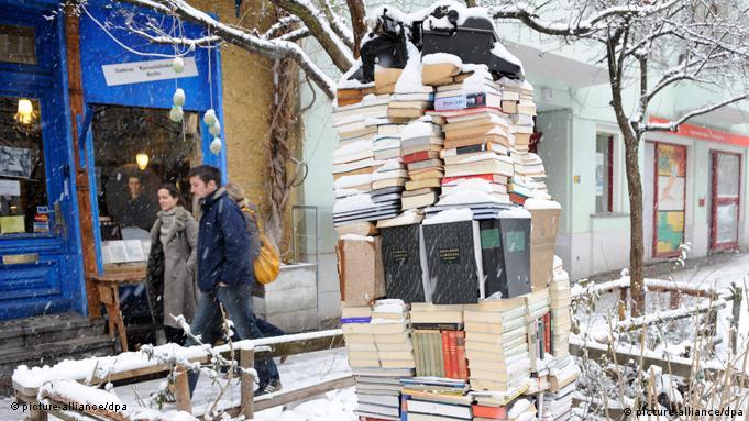 A tower of books outside of a store in Kreuzberg, Berlin