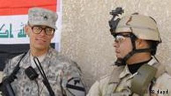 An Iraqi and a US Army soldier during a handover ceremony