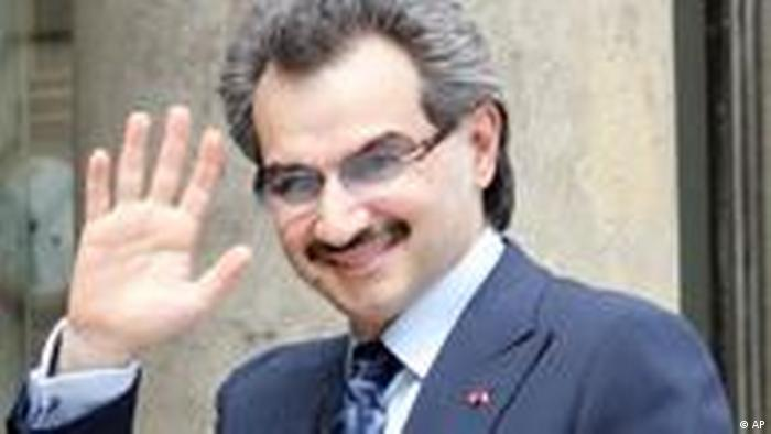 Saudi Prince Alwaleed Bin Talal Bin Abdul aziz Al Saud waves at the Elysee Palace prior to lay the cornerstone of the new Islamic art rooms of the Louvre museum in Paris, Wednesday July 16, 2008. (AP Photo/Francois Mori)