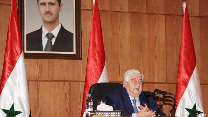 Der syrische Machthaber war stets präsent: Walid al-Muallim bei einer Pressekonferenz 2011 in Damaskus (Foto: dapd)