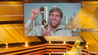Dirk Nowitzki accepts his award by a television link