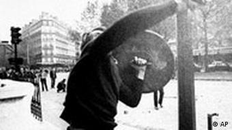 A demonstrator throwing rocks at police during a protest in Paris in May, 1968