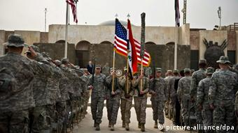 US colors being retired at the end of mission ceremony in Baghdad, Iraq
