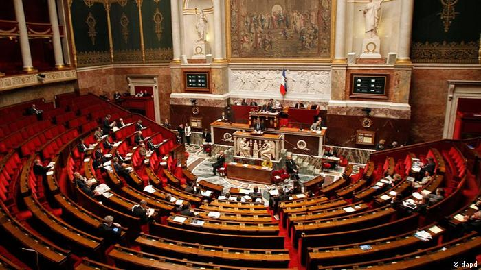 General view of the French parliament during the debate of the Armenian Genocide in Paris, Thursday, Dec. 22, 2011. Lawmakers are to vote on a measure that would make it a crime in France to deny that the mass killings of Armenians in 1915 amounted to a genocide, a measure that could put France on a collision course with Turkey, a strategic ally. Turkey wants the killings left to historians and has lashed out at France, warning that it will withdraw its ambassador if the measure becomes law.( AP Photo/Michel Euler)