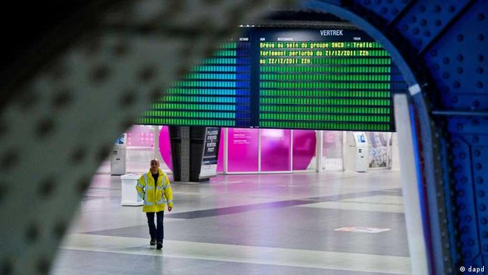 A man walks across the empty concourse at Brussels South railway station in Brussels