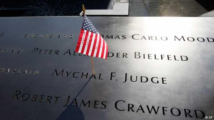 An American flag is stuck into the etched name of a vicitim of the Semptember 11 attacks at the National September 11 Memorial in New York City