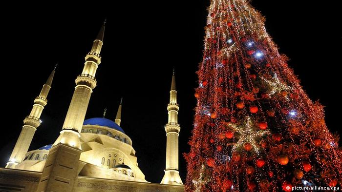 Christmas tree lights are switched on in front al-Amine Mosque in central Beirut, Lebanon, December 2008 (Photo: Wael Hamzeh)