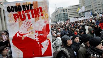 Demonstrators hold Russian opposition flags during a rally protesting against election fraud in Moscow