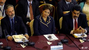 Brazil's Foreign Minister Antonio Patriota, left, Brazil's President Dilma Rousseff, center, and Venezuela's Foreign Minister Nicolas Maduro, left, look on as they attend the Mercosur summit in Montevideo, Uruguay,Tuesday, Dec. 20, 2011. South America's Mercosur trade bloc approved a Palestinian free trade deal Tuesday and then pushed to admit Venezuela as a full member, even at the cost of threatening its founding principles. (AP Photo/Matilde Campodonico)
