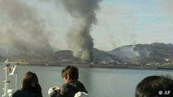 Smoke is seen at Yeonpyeong island near the border against North Korea, in South Korea