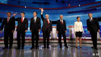 Republican presidential candidates from left, former Pennsylvania Sen. Rick Santorum, Texas Gov. Rick Perry, former Massachusetts Gov. Mitt Romney, former House Speaker Newt Gingrich, Rep. Ron Paul, R-Texas, Rep. Michele Bachmann, R-Minn., and former Utah Gov. Jon Huntsman arrive for a Republican presidential debate in Sioux City, Iowa, Thursday, Dec. 15, 2011. (AP Photo/Eric Gay)