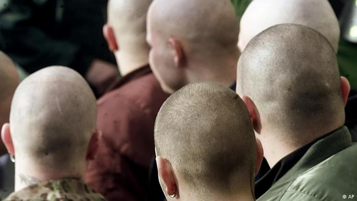 Skinhead neo-Nazis from behind