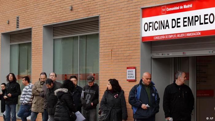 People line up to enter a government employment benefit office in Madrid, Wednesday March 2, 2011. The number of people signing up for unemployment benefits in Spain rose by 68,260 in February to just under 4.3 million, setting a new record as the country struggles to overcome recession.(AP Photo/Daniel Ochoa de Olza)
