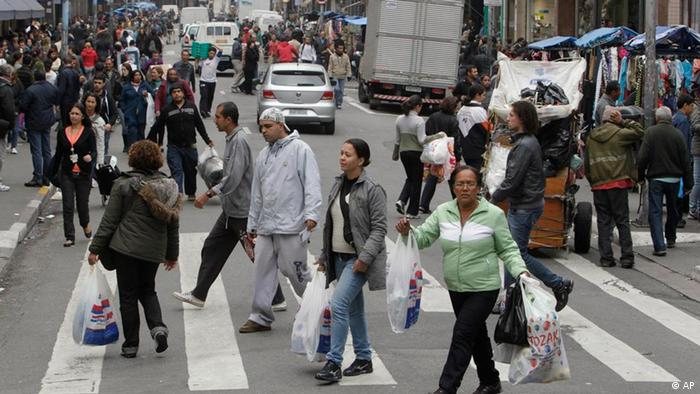 Shoppers crossing the road in Sao Paulo, Brazil. (AP Photo/Andre Penner)