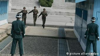A North Korean soldiers walk at the Military Demarcation Line in the Demilitarized Zone (DMZ) i