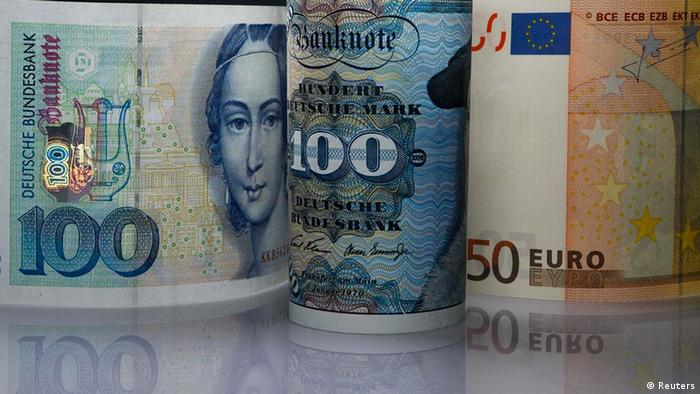 One hundred deutschmark notes and fifty Euros notes side by side