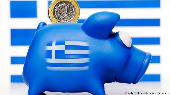 Piggy bank with Greek flag