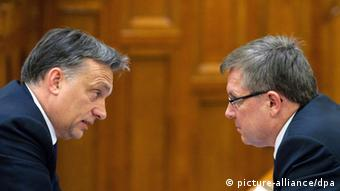Hungarian Prime Minister Viktor Orban speaks to Hungarian Minister of Economy Gyorgy Matolcsy