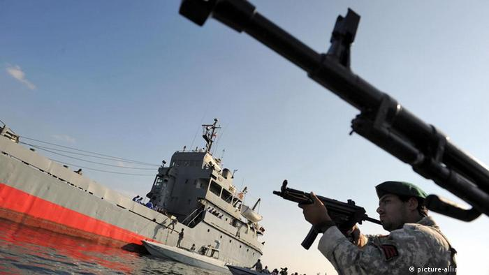 Iranian navy soldiers take part in a military exercise in the straight of Homruz in the Oman Sea