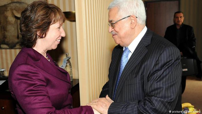 A handout photograph provided by the Palestinian Authority shows Palestinian President Mahmoud Abbas meeting with European Union Foreign and Security Policy Chief Catherine Ashton