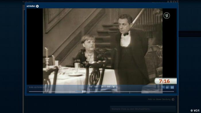 Angela Merkel and Nicolas Sarkozy in a parody of Dinner for One