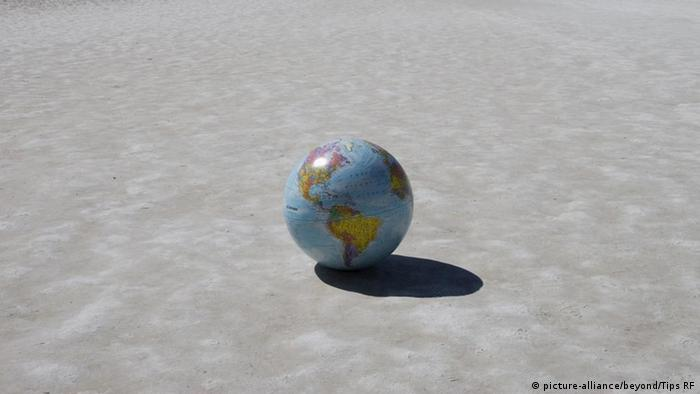 Globe on dried earth