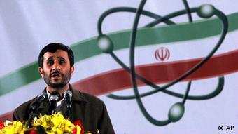 Iranian President Mahmoud Ahmadinejad, speaks at a ceremony in Iran's nuclear enrichment facility in Natanz, 300 kms 186 (miles) south of capital Tehran, Iran, Monday April, 9, 2007. Iran announced Monday that it has begun enriching uranium with 3,000 centrifuges, a dramatic expansion of a nuclear program that has drawn U.N. sanctions and condemnation from the West. President Mahmoud Ahmadinejad said Monday at a ceremony at the enrichment facility at Natanz that Iran was now capable of enriching nuclear fuel on an industrial scale. Asked if Iran has begun injecting uranium gas into 3,000 centrifuges for enrichment, top nuclear negotiator Ali Larijani replied, Yes. He did not elaborate, but it was the first confirmation that Iran had installed the larger set of centrifuges after months of saying it intends to do so. (AP Photo/Hasan Sarbakhshian)