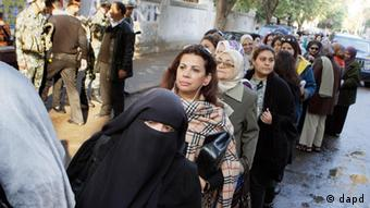 Egyptian women line up out side a polling center in Cairo, Egypt, Monday, Nov. 28, 2011 . Voting began on Monday in Egypt's first parliamentary elections since longtime authoritarian leader Hosni Mubarak was ousted in a popular uprising nine months ago. The vote is a milestone many Egyptians hope will usher in a democratic age after decades of dictatorship. (AP Photo/Amr Nabil)