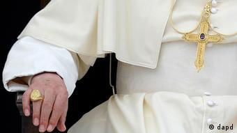 Pope's torso and hand with ring on